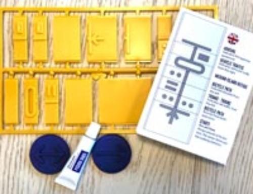 Reliefsymboler och taktil riktningspil – ett kit